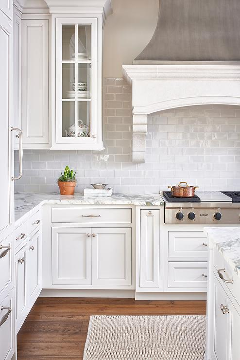 The white kitchen is my favorite! White cabinets and white counters are just so pretty and clean.