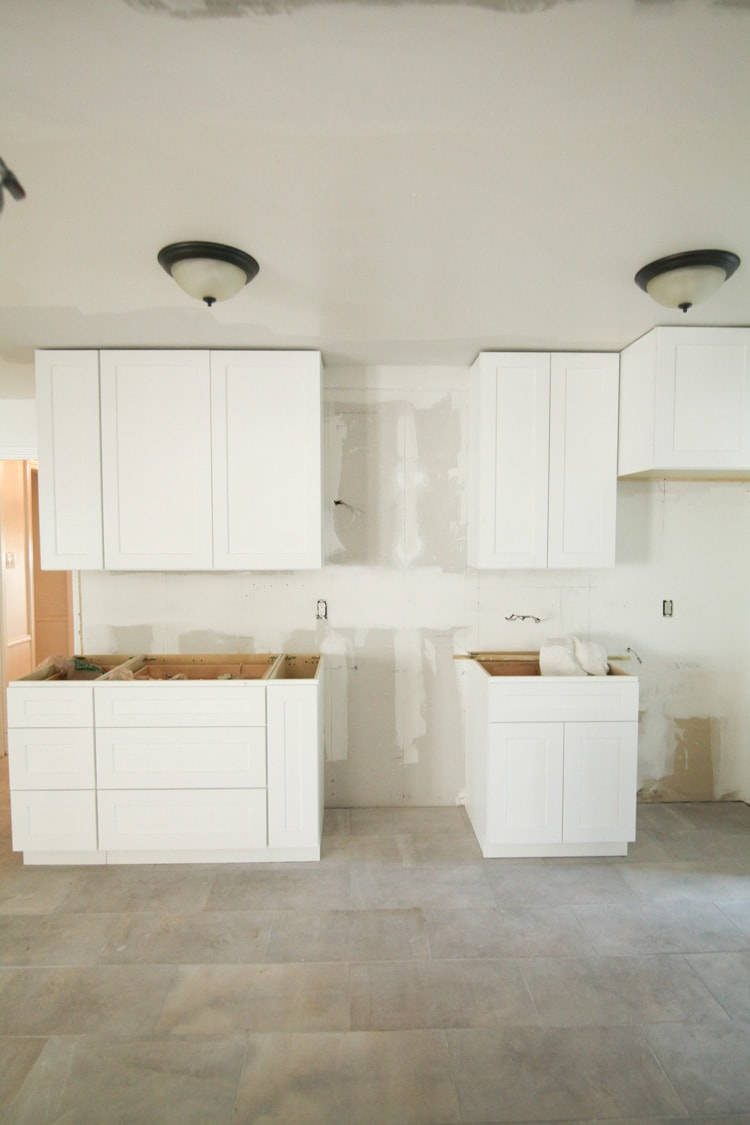 Love this kitchen remodeling post! They opened the galley kitchen - looks so beautiful!