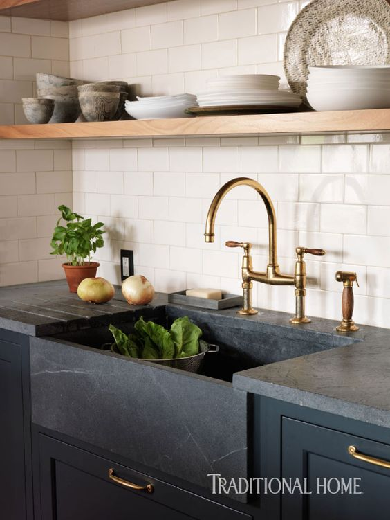 I never thought about using soapstone counters until I saw this! I had no idea how cheap soapstone countertops could be - and how gorgeous! Love the integrated sink.