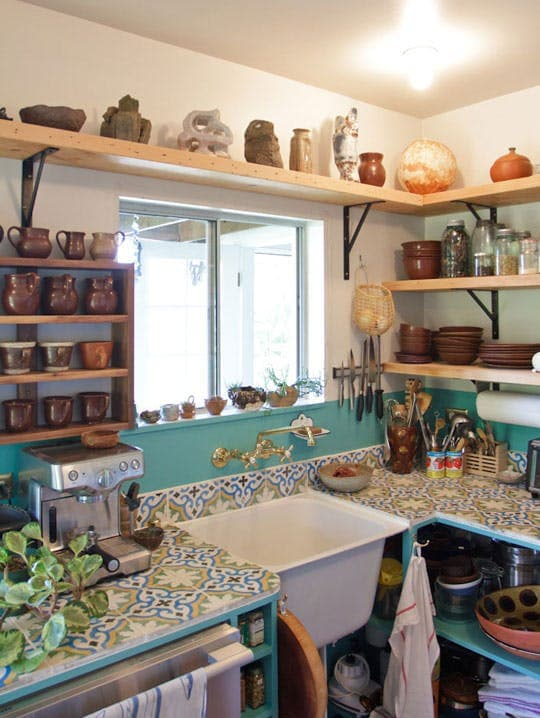 This house is so cute! I love these tile countertops - so creative! Great cheap kitchen counters.