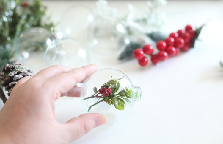 This easy diy christmas ornaments take a minute or less to put together! I've been searching for a new way to use clear glass ornaments...love this rustic idea!