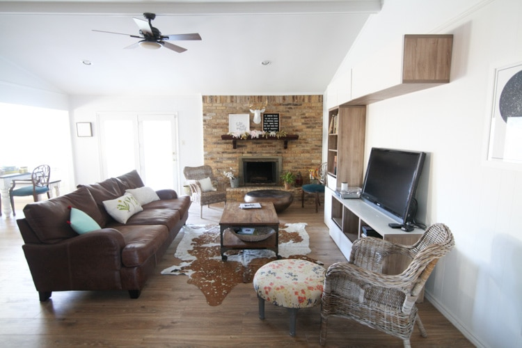 This living room makeover on a budget is awesome! I love the bright, white walls and the brick fireplace. This is one of my favorite sites for before and after home renovations.