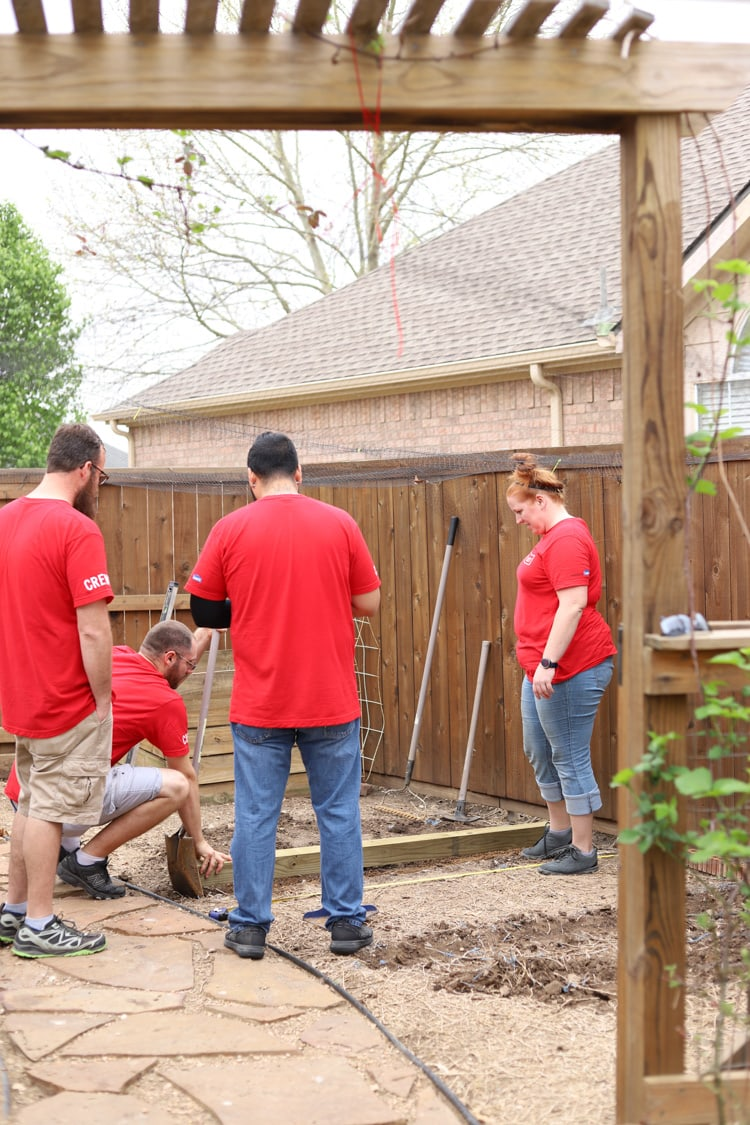 Crew leveling space in a backyard