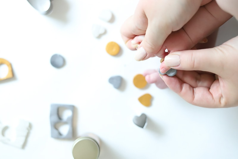 baby finger pressed into clay for personalized keychains with thumbprints