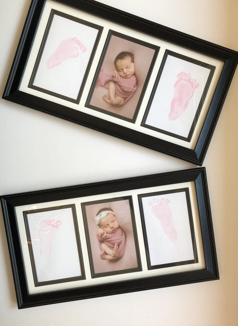 frame with newborn baby picture and two pink foot prints