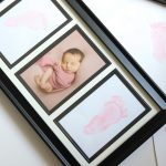 picture frame with baby foot prints and newborn photo