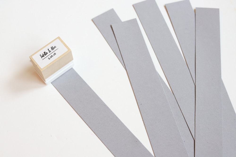 stamping gray strips of paper