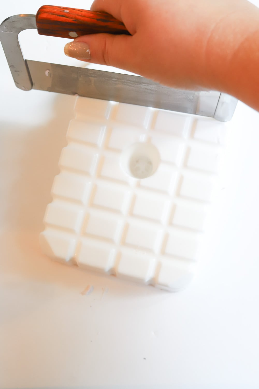 Cutting a bar of soap to make melt and pour soap