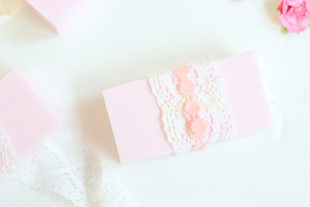 soap with white lace and pink ribbon