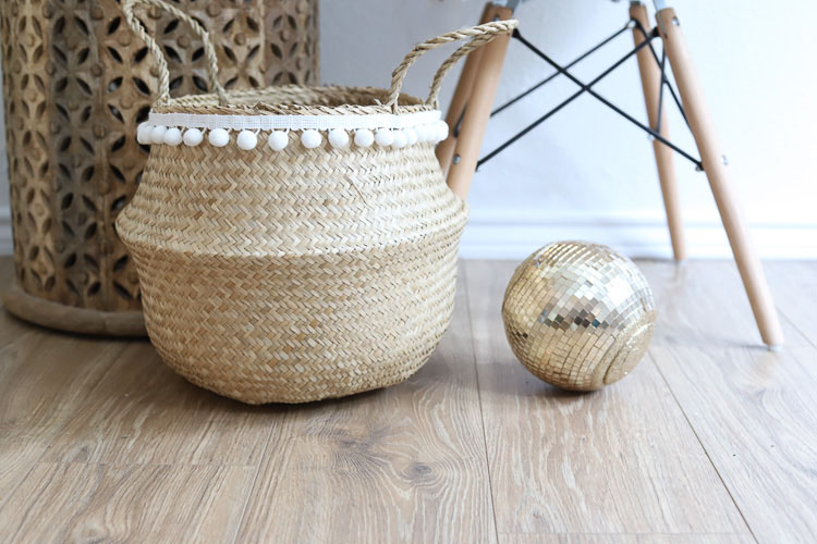 wicker basket with white pom pom trim