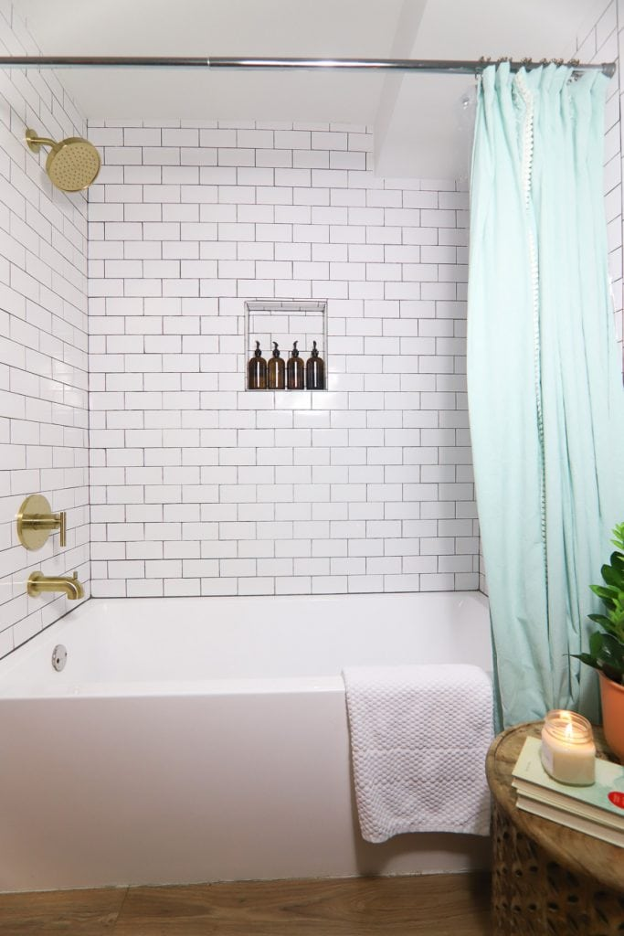 shower remodel with brushed gold fixtures
