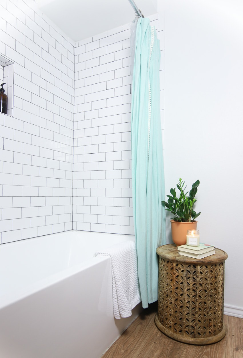 blue shower curtain with subway tile