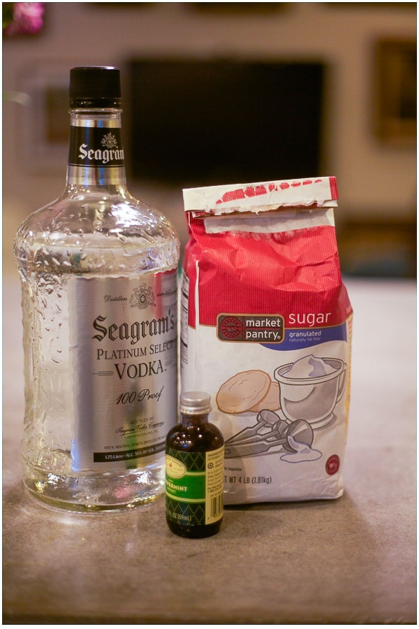 Ingredients needed to make diy peppermint vodka including vodka, sugar, peppermint extract.