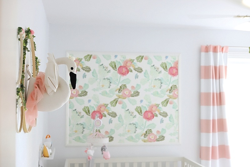 swan bust as nursery wall decor with floral wallpaper in background
