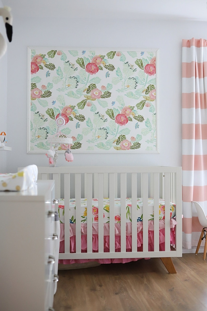 Pink and white baby girl nursery with floral theme