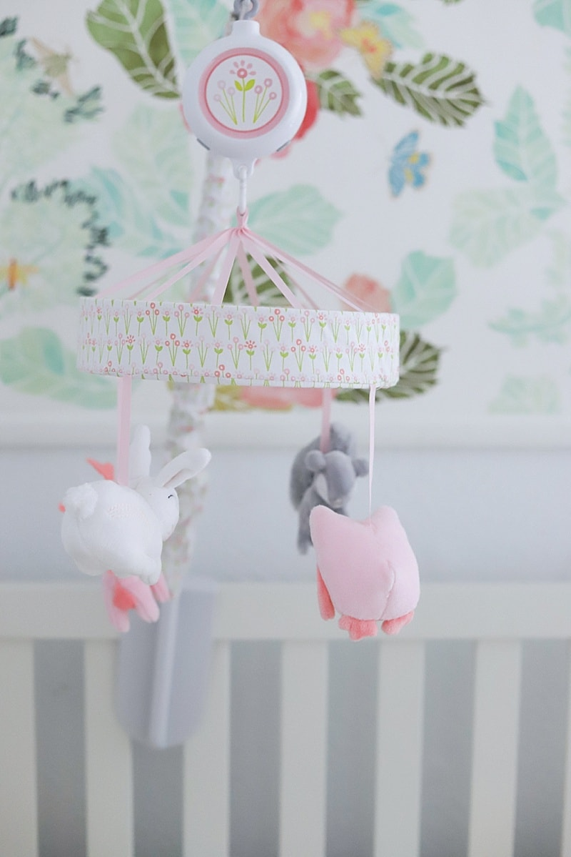 Pink and gray crib mobile in a baby girl nursery