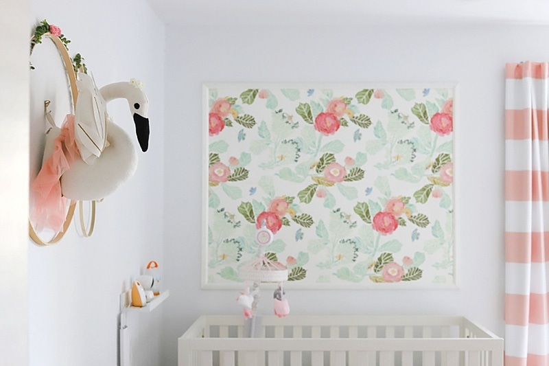 watercolor floral nursery wallpaper in a baby girl nursery