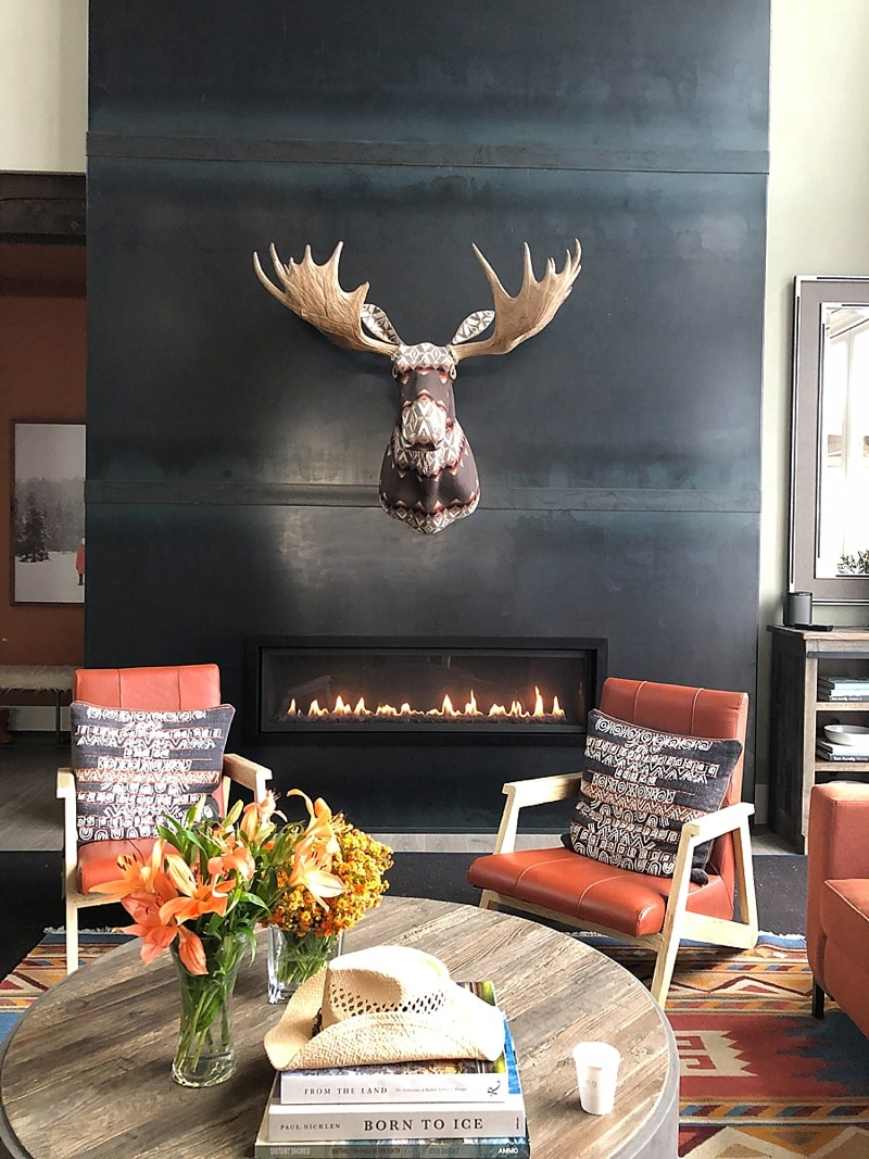 Stuffed moose on a dark fireplace