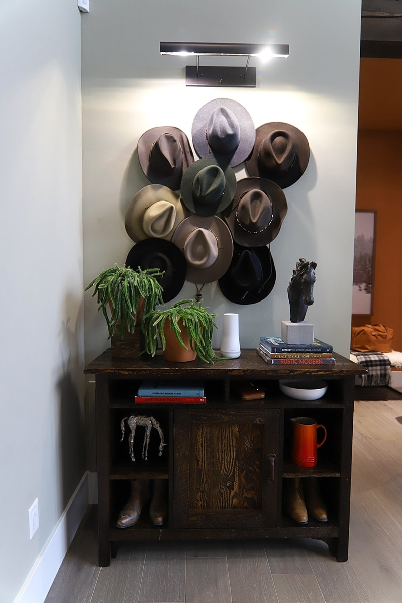 Cowboy hats as decor above an entryway table as entryway deco.