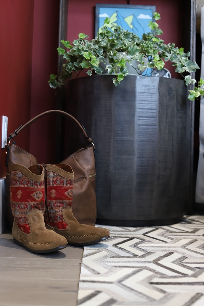 Cute Kilim boots and bag in front of a side table