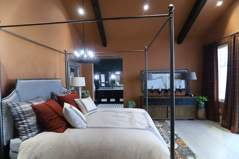 Master bedroom with orange walls and ceilings, and a canopy bed