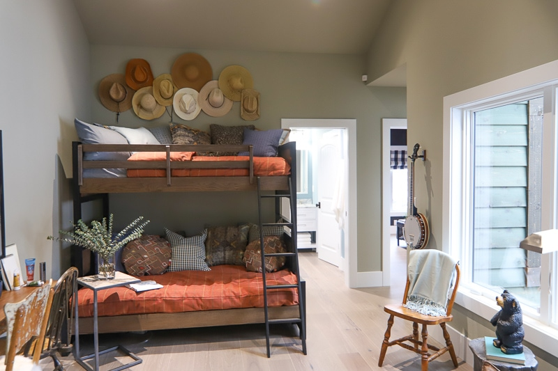 Bunkbeds in a bonus room with cowboy hats as decor at the HGTV dream home 2019