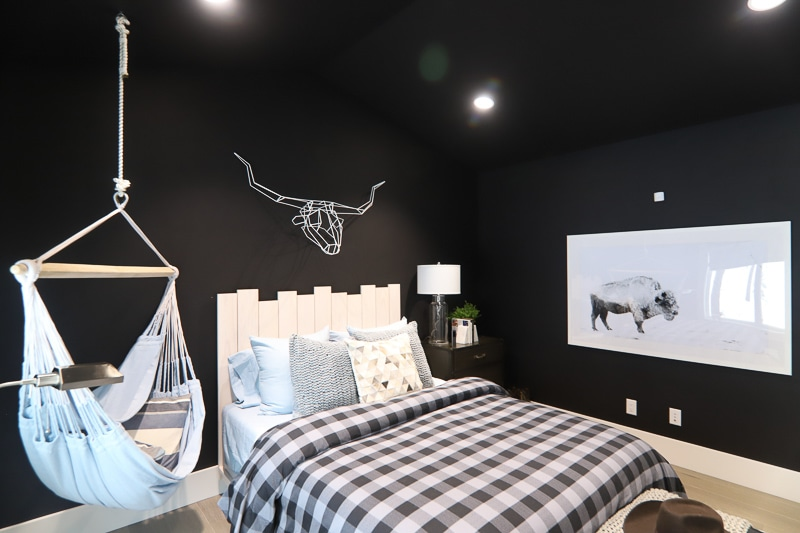 All black room with white art and headboard