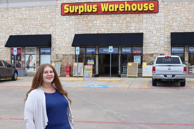 Woman standing in front of Surplus Warehouse store
