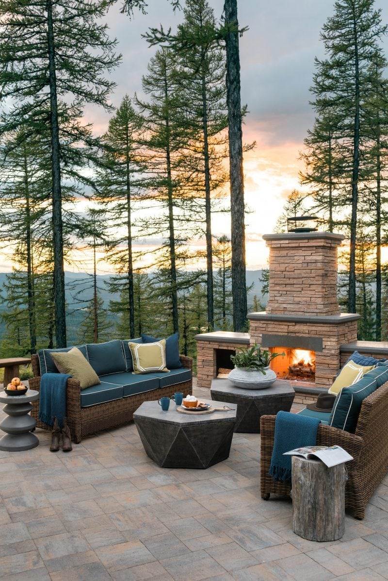 Outdoor fireplace in woods
