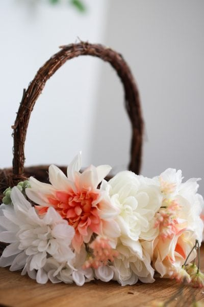 An Easter basket decorated with white flowers
