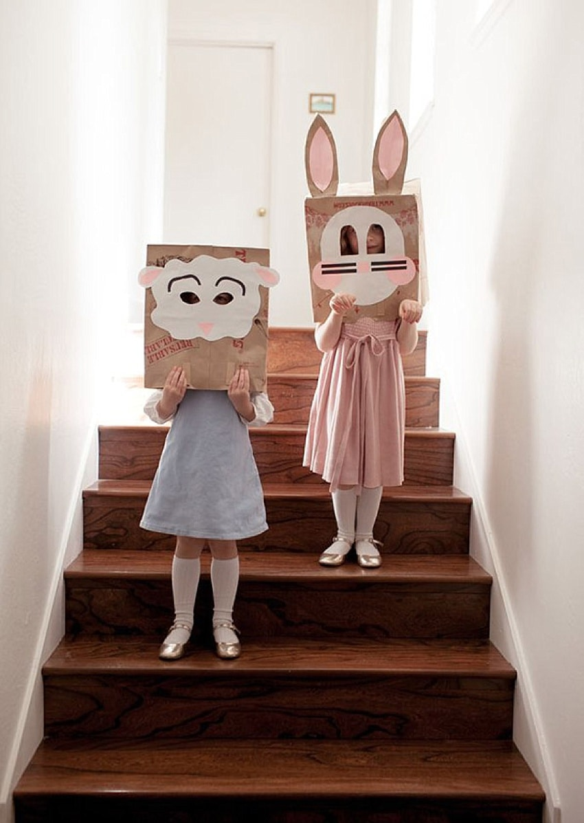 Easy Easter craft for kids - two girls with bunny masks made from paper bags