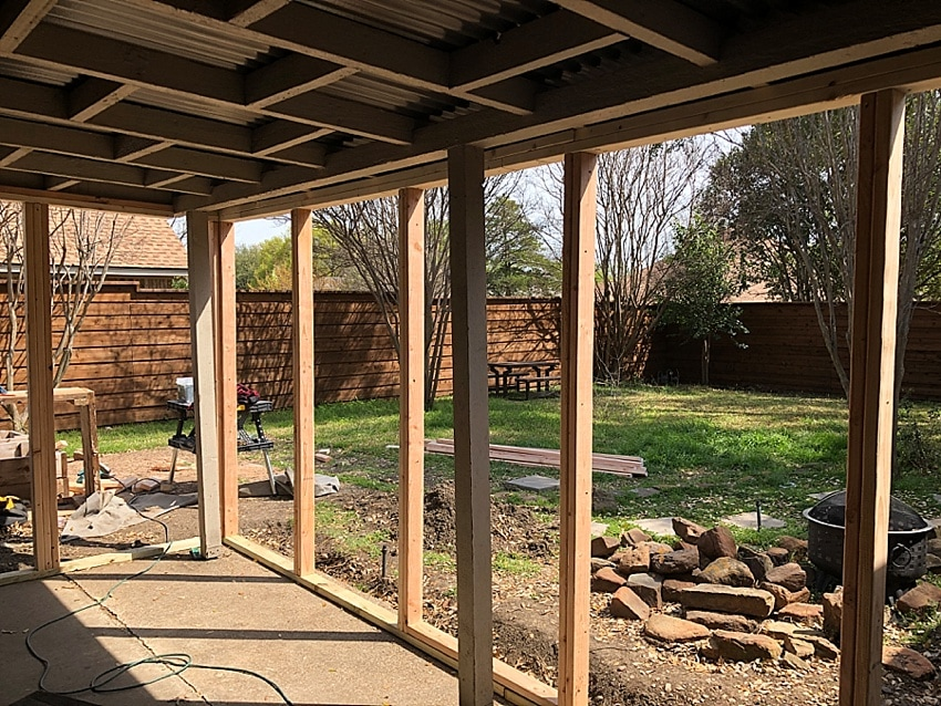 Framing for a diy sunroom made out of a covered patio