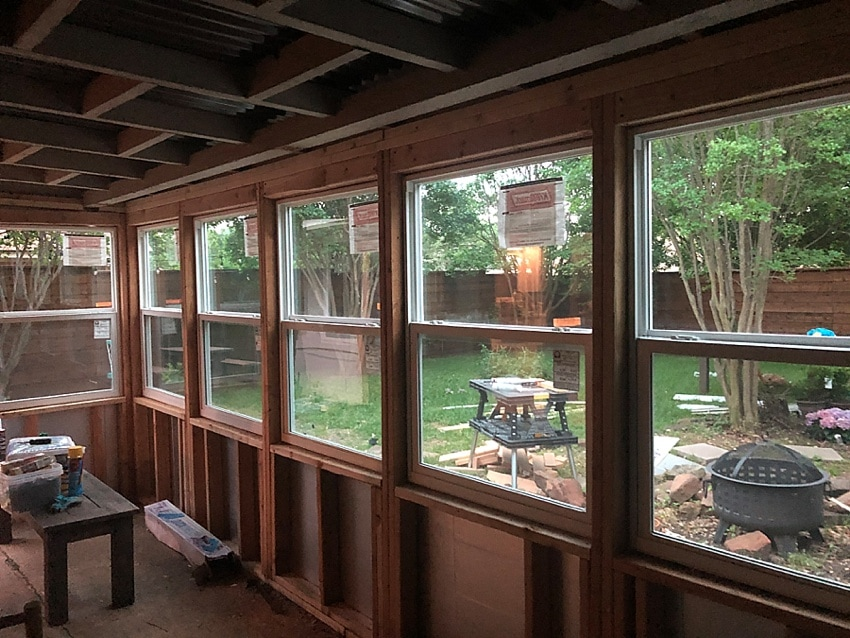 How to build a diy sunroom - turning a covered patio into a sunroom!