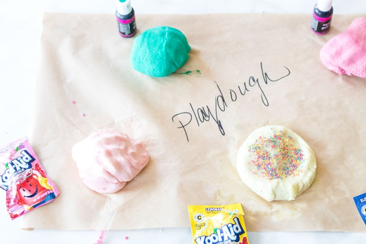 Playdough with koolaid on paper