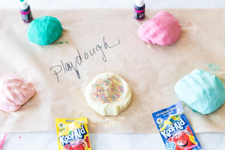 Playdough on wax paper with sprinkles