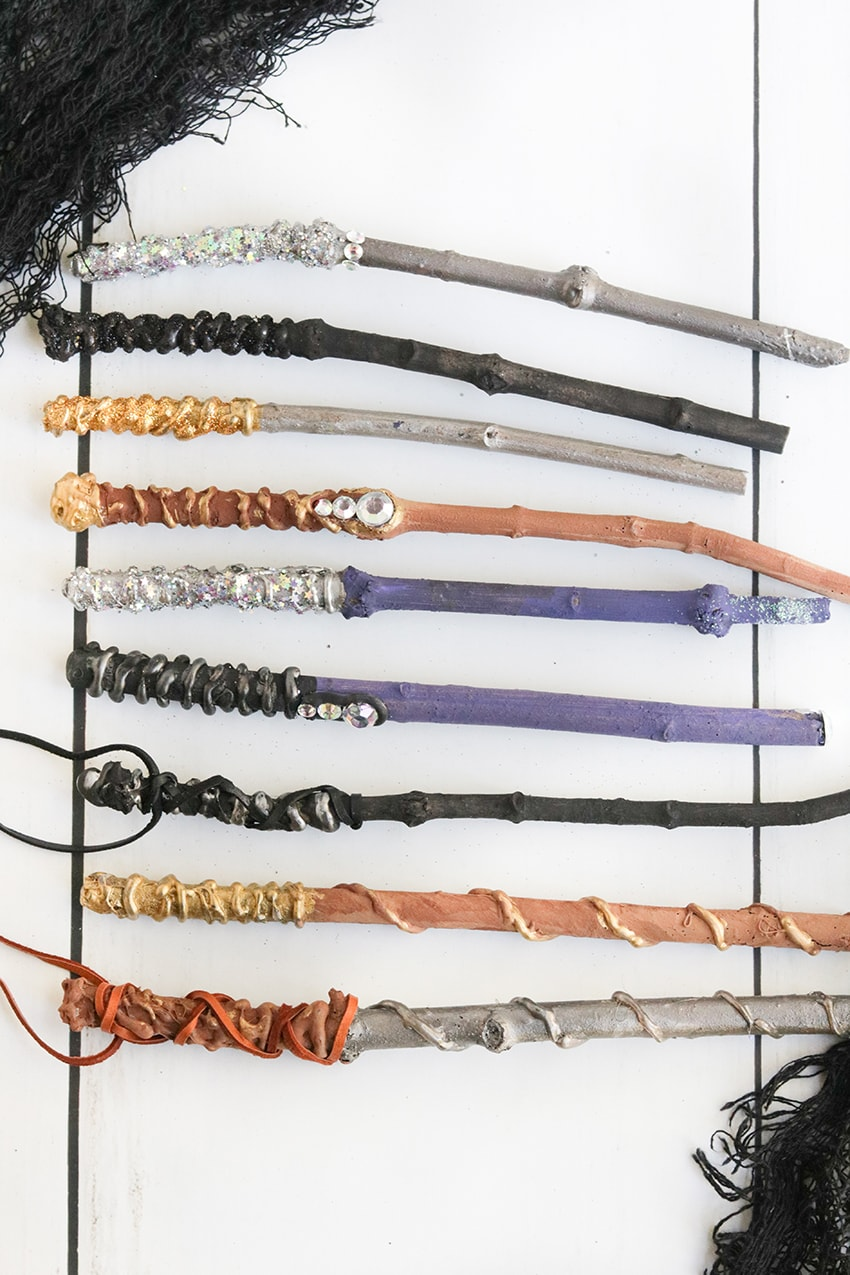painted diy wands from harry potter made with gemstones, glitter, paint and ribbon