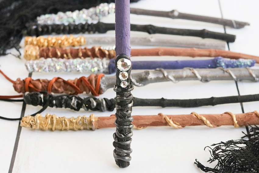 Purple painted wand covered in black tip embossed with gemstones