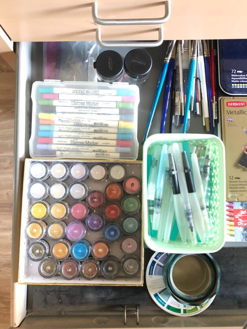 drawer filled with organized watercolor supplies.