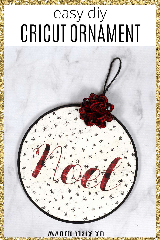 Mini embroidery hoop with noel on it