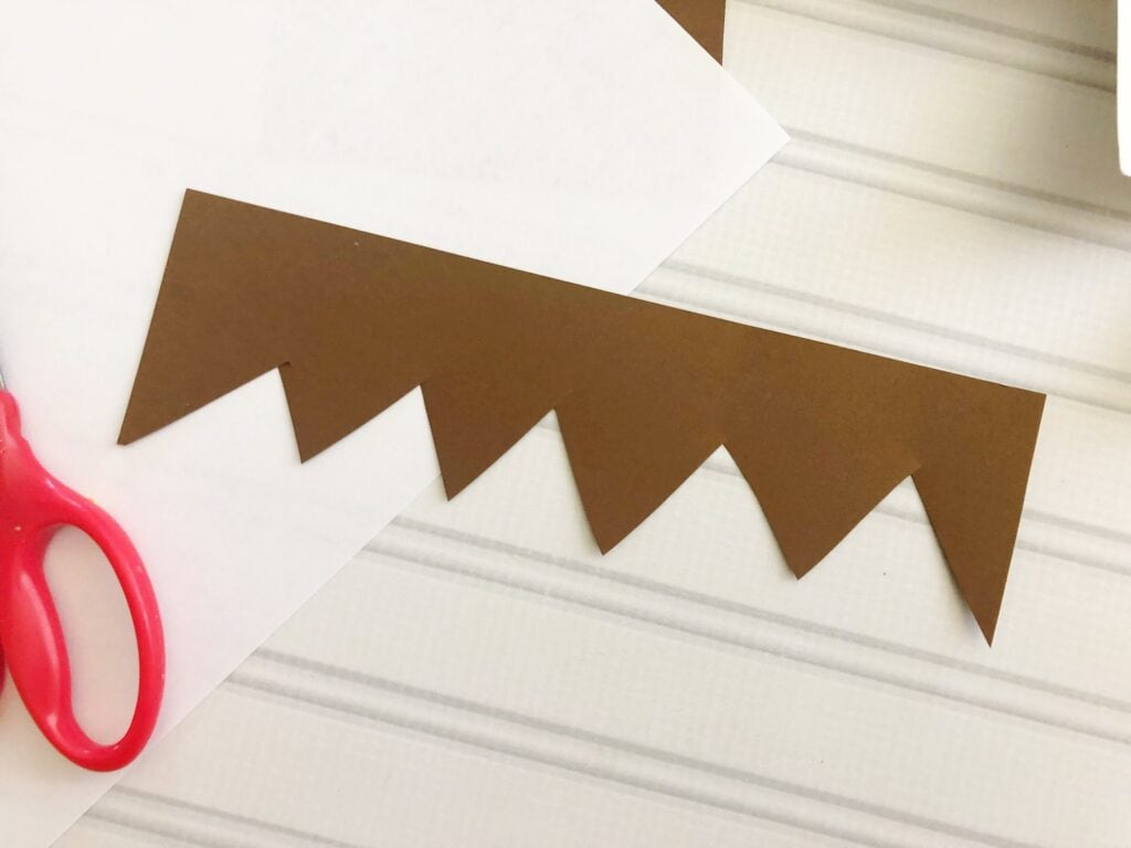 Brown craft paper cut out to look like hair for the elf on the shelf craft.