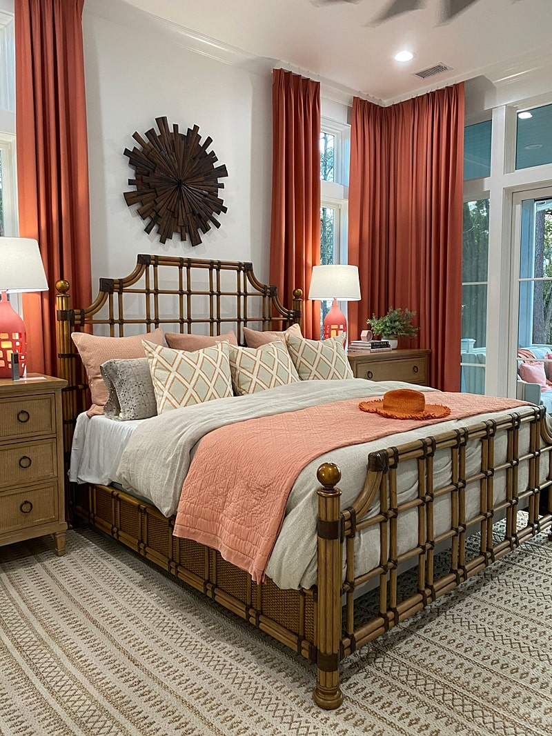 master bedroom with rattan bed and coral curtains