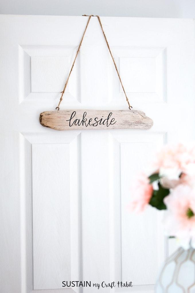 handmade wooden sign on a white door
