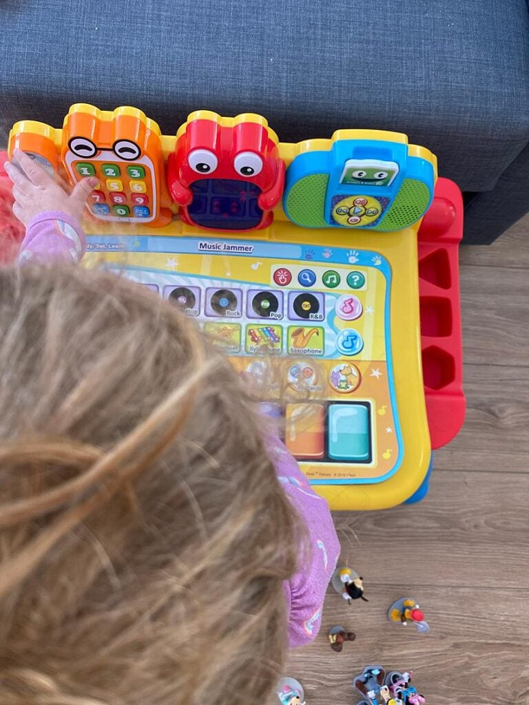 Toddler playing with an age appropriate educational game