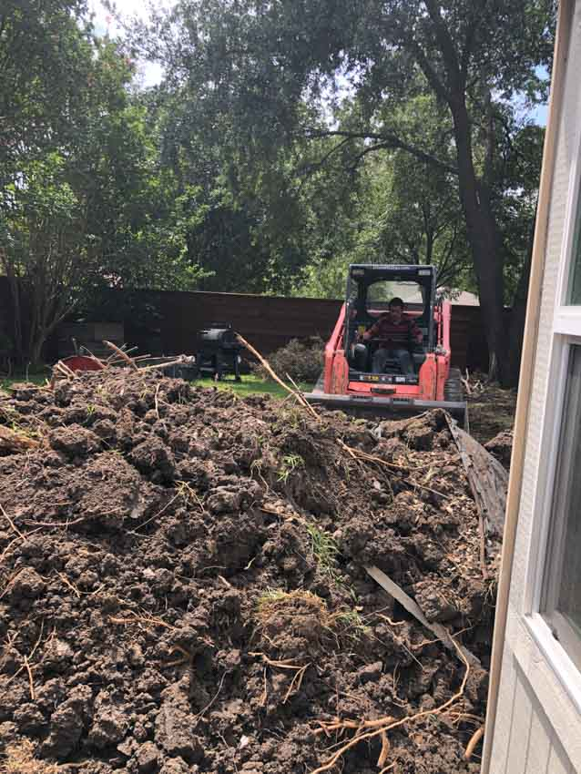 Pile of dirt being removed from patio makover