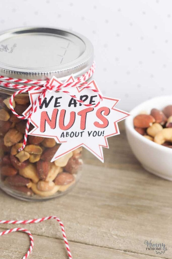 """A jar of nuts with a tag that says """"We are nuts about you"""""""