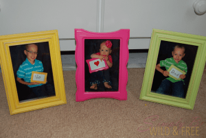 3 picture frames - yellow, pink, and green