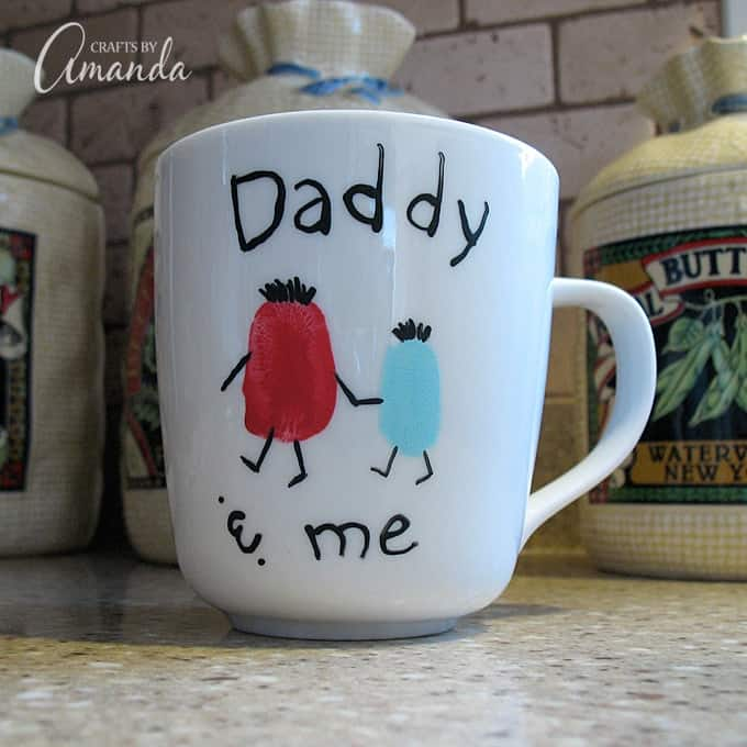 """a white coffee cup that says """"Daddy and me"""""""