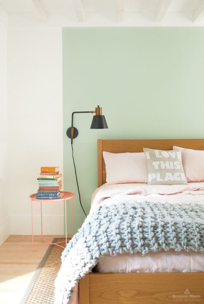 Colorful, modern bedroom with pastel color scheme and accent wall painted in Benjamin Moore Crystalline