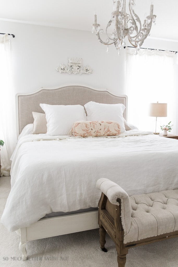 French vintage master bedroom with chandelier painted in Benjamin Moore Simply White