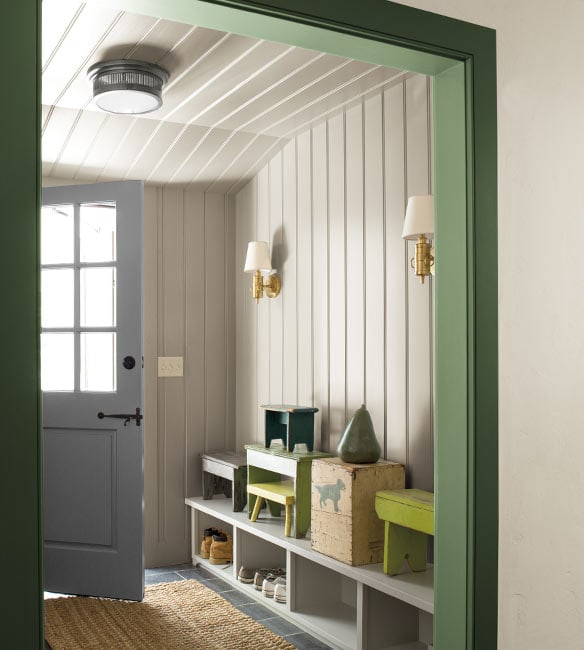 Entryway with shoe storage cabinets and gray door, off-white walls and trim Nicolson Green by Benjamin Moore.